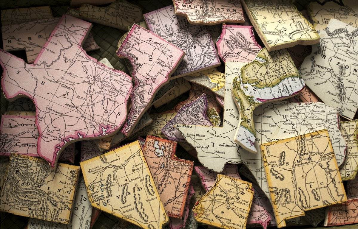 A pile of US states cut out of a map.