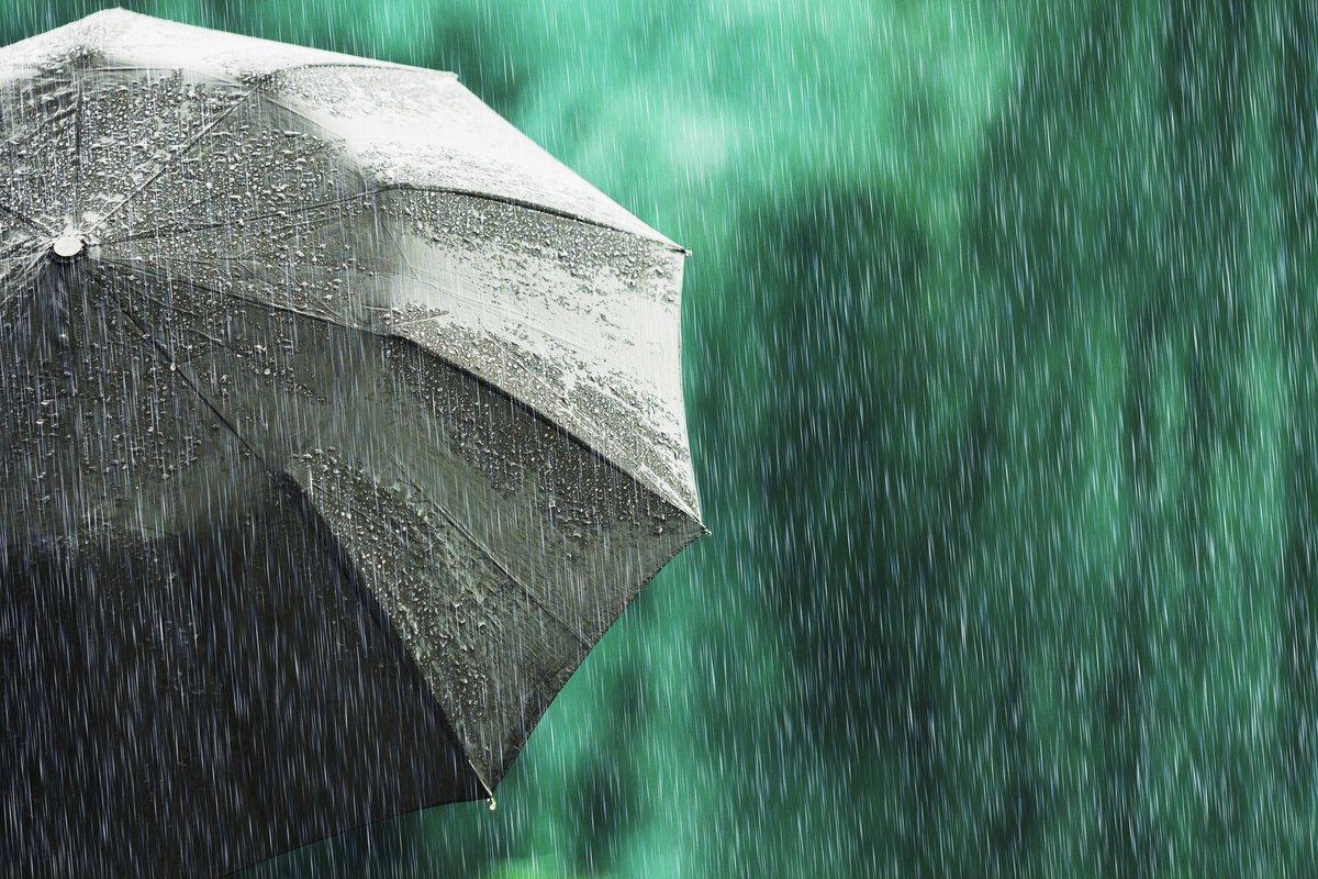 An open umbrella in a light rain.