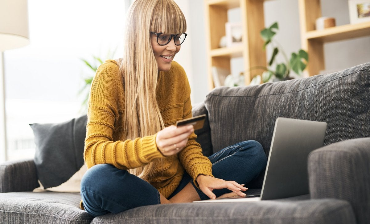Woman On Sofa With Credit Card