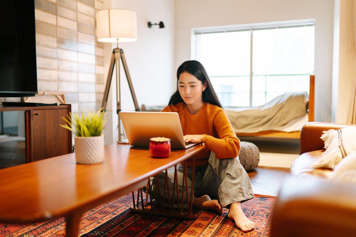 Woman Thinking At Laptop