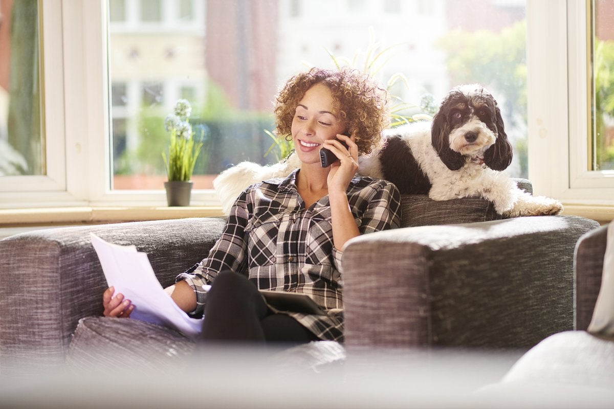 Woman With Dog Talking On Phone