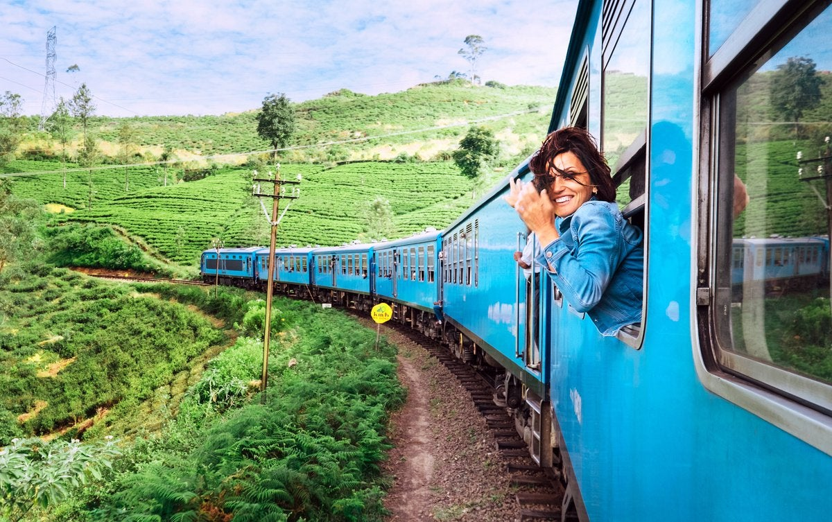 A woman leaning out of a train window.