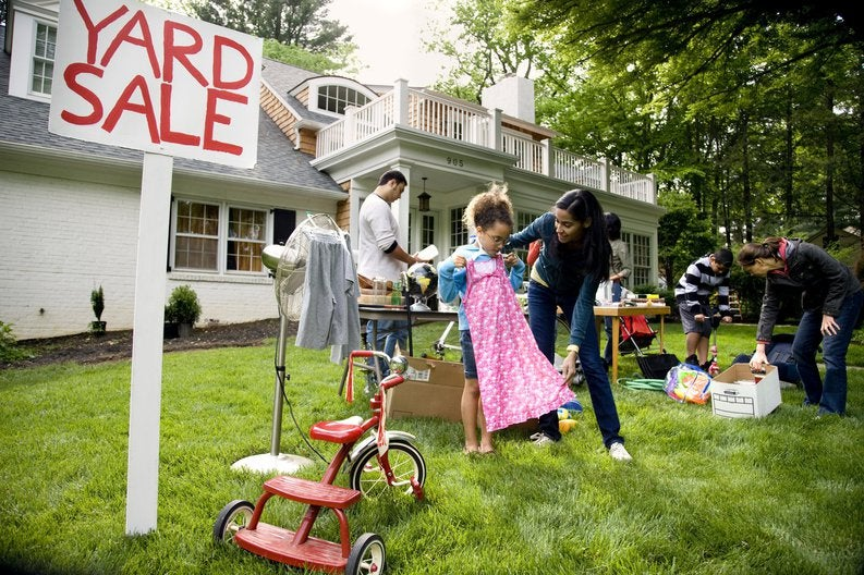 People browsing items at a yard sale.