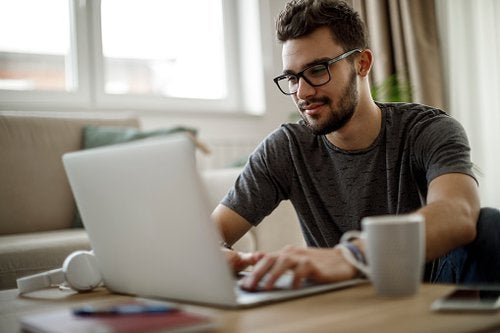 Young Man Looking At Laptop