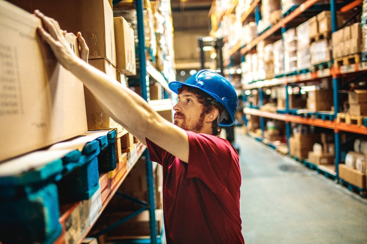 Young Man Working In Warehouse