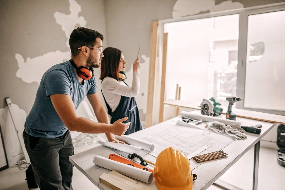 Young couple working together on a home remodel project.