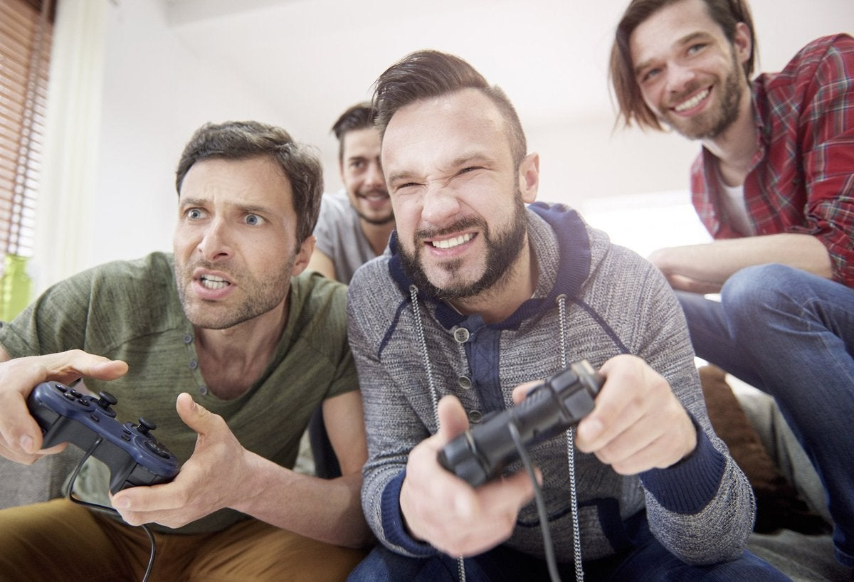 Group of adults playing a video game together.