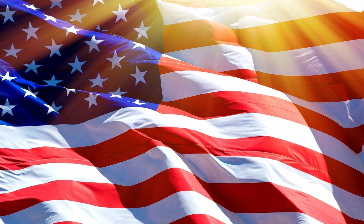 An up-close shot of American flag moving in the wind.