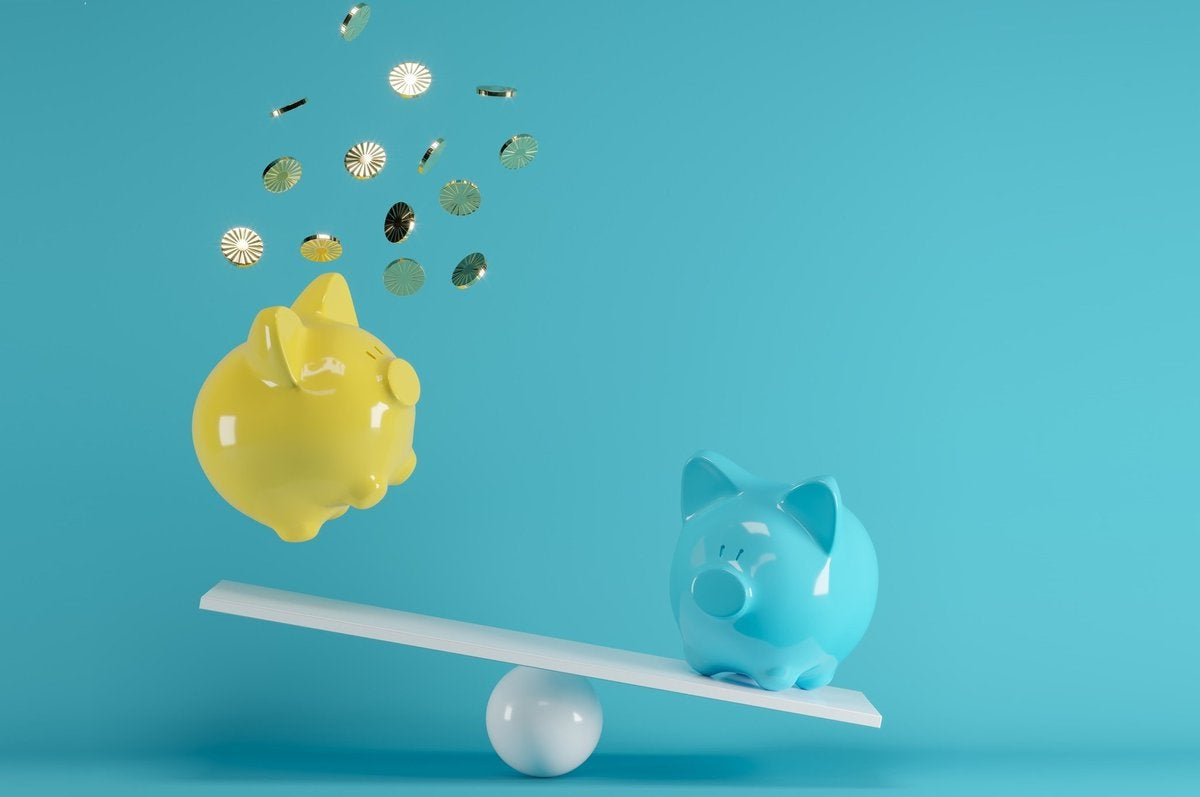 blue piggy bank sending yellow piggy bank flying off a seesaw.