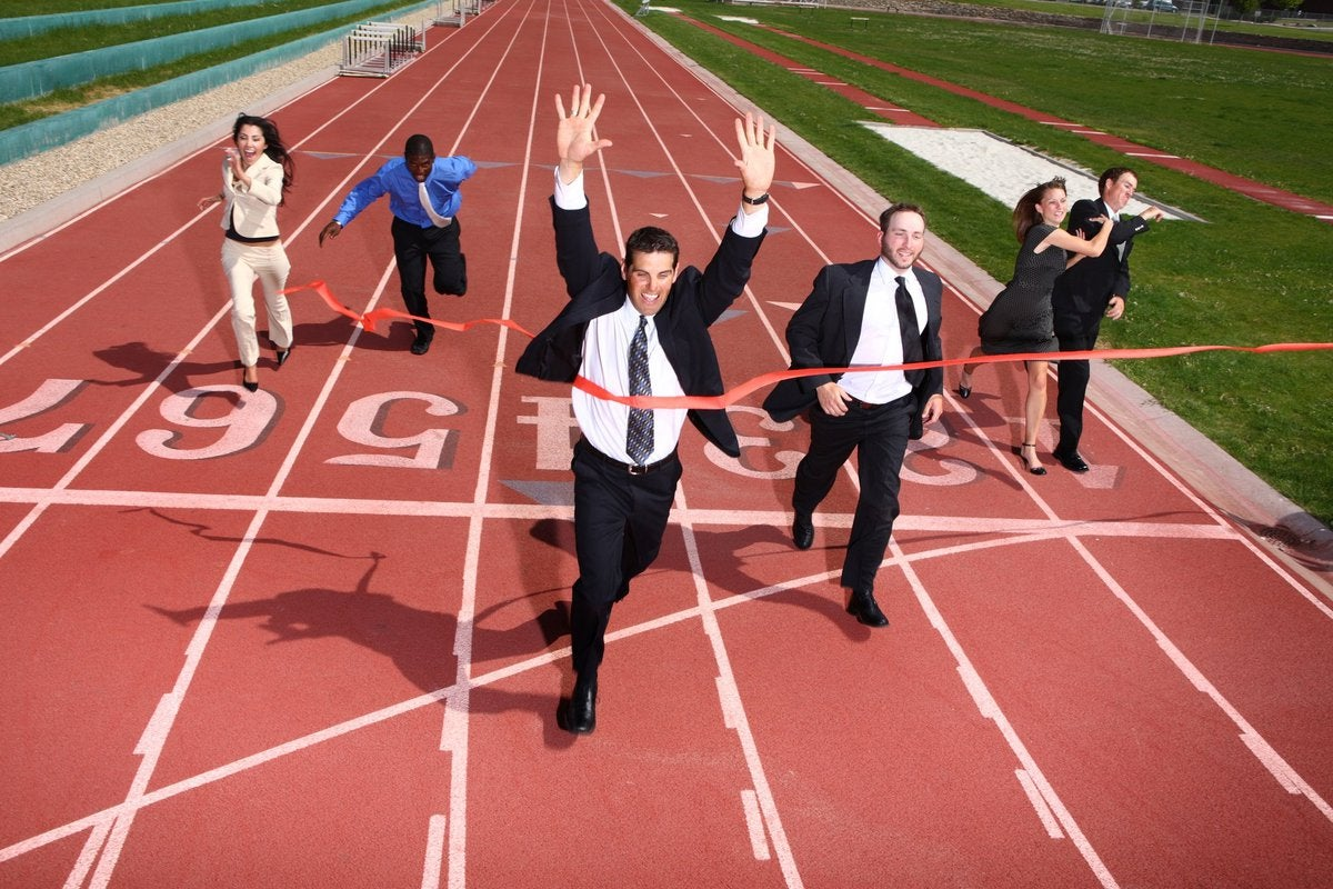business people finishing a race