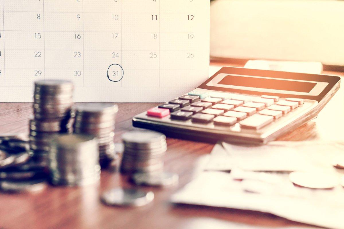 calendar, calculator, and money on table