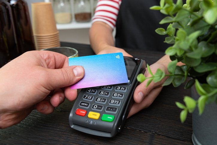 Someone pays with a contactless credit card.