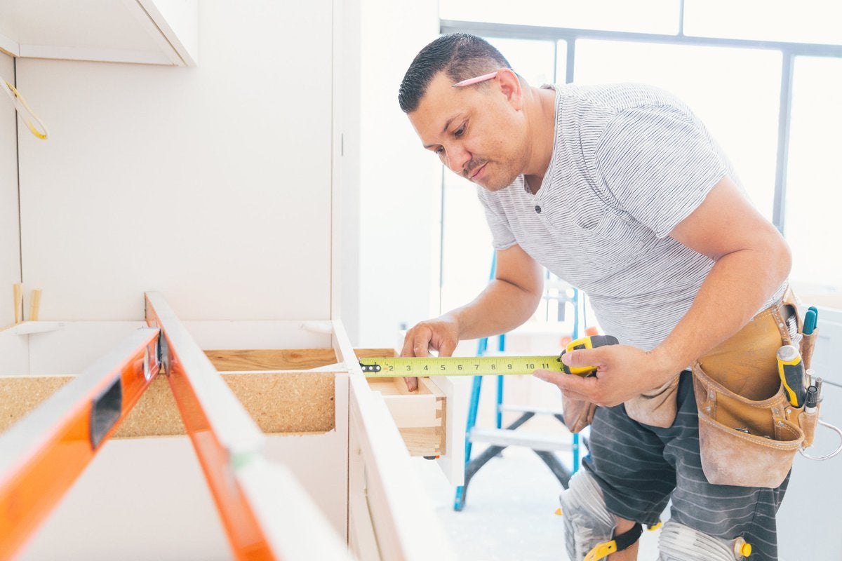 A contractor working on a kitchen renovation.