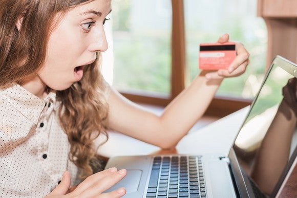 A woman checking out her credit score on her laptop.