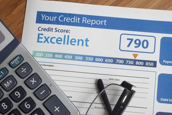 A sheet of paper title Your Credit Report showing an Excellent rating and a score of 790.