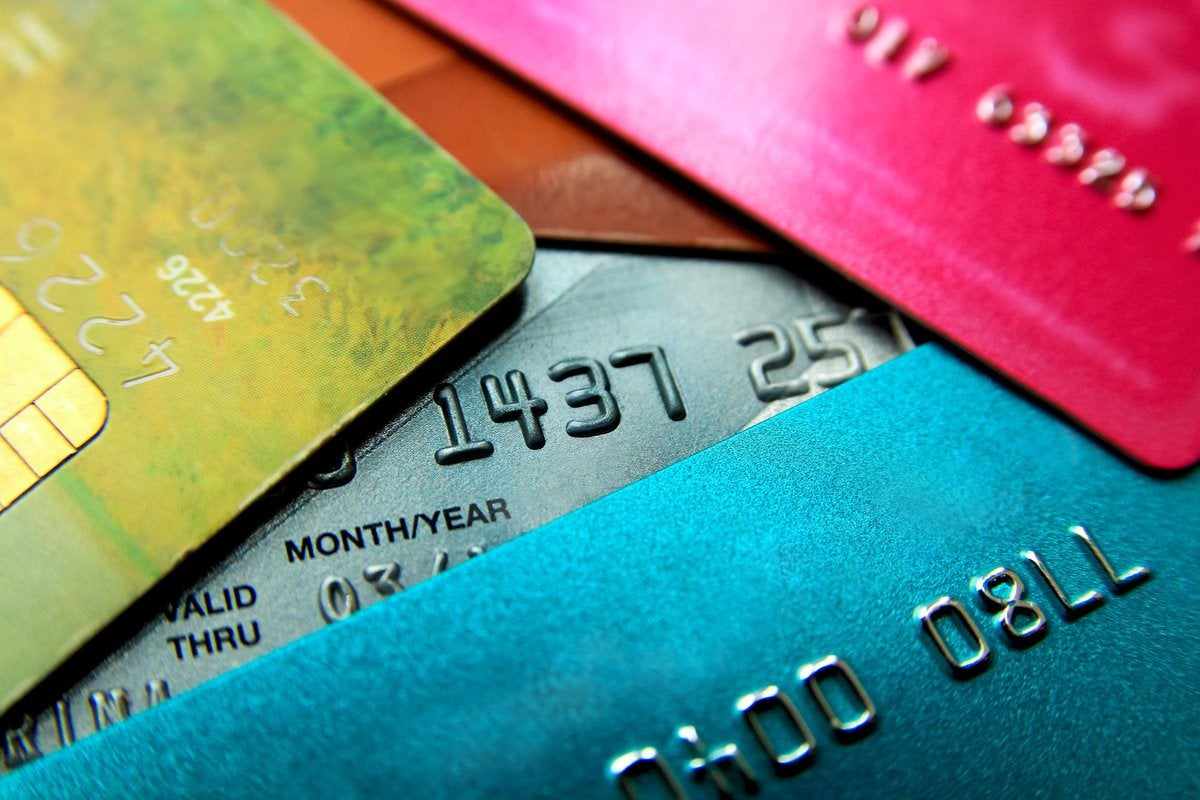 A stack of colorful credit cards.