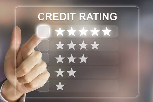 A screen reading Credit Rating with options of one to five stars with a finger pointing to five stars.