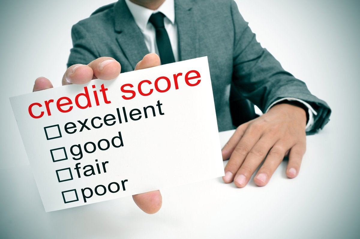 Man holding credit score scorecard.