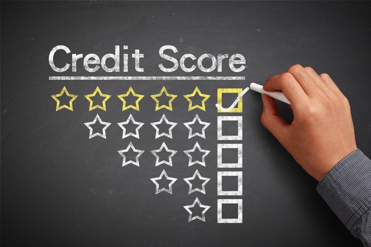 Chalkboard that says Credit Score with decreasing levels of stars and a hand checking the box next to 5 stars