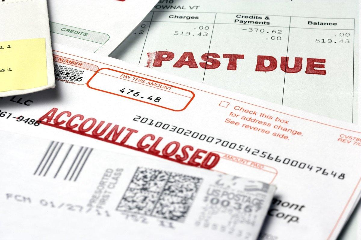 Stack of past due debt bills.