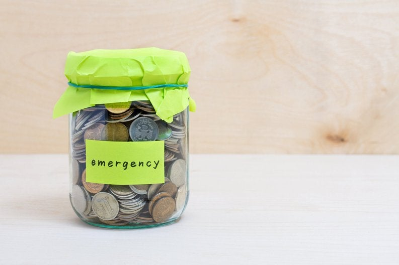 """Jar of coins with """"emergency"""" label"""