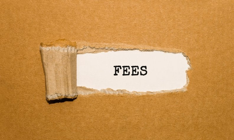 A piece of cardboard torn to reveal the word FEES.