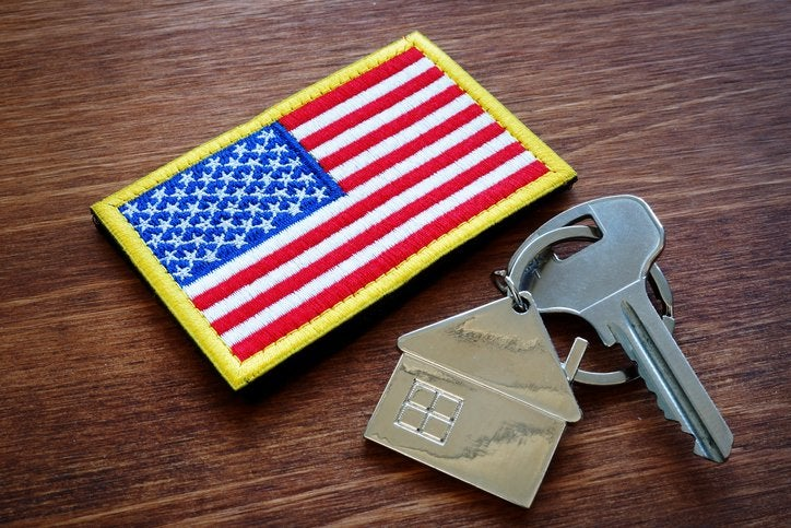 A flag patch and house key on a table