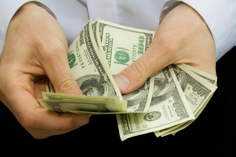 hands handling money