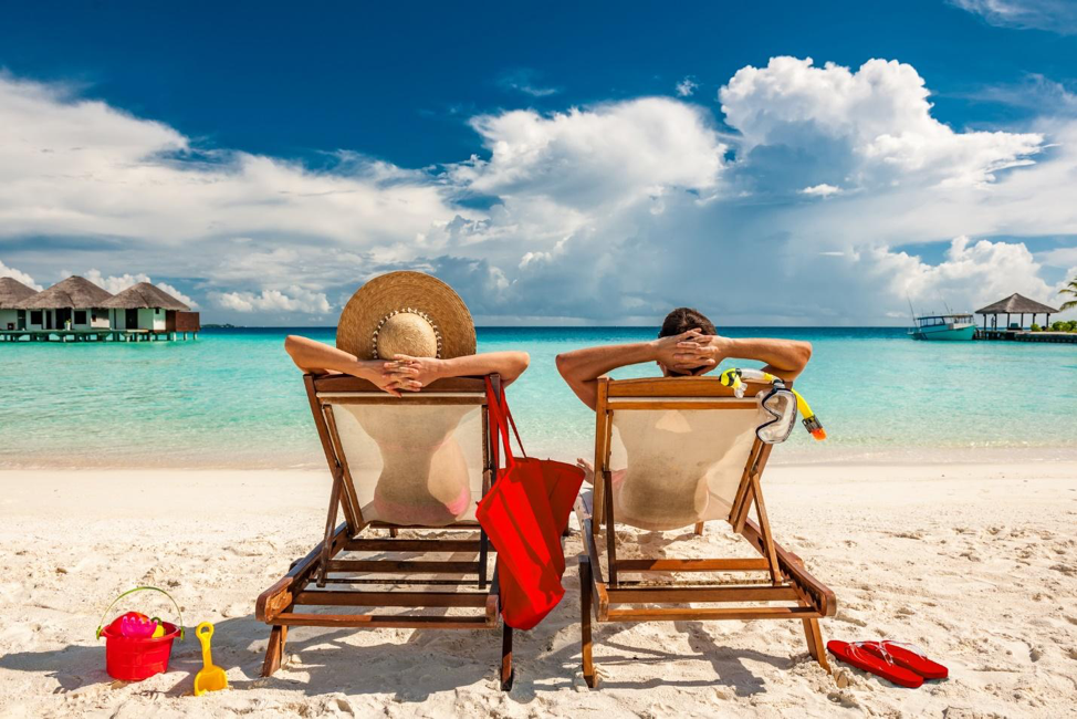 man and woman in beach chairs.png