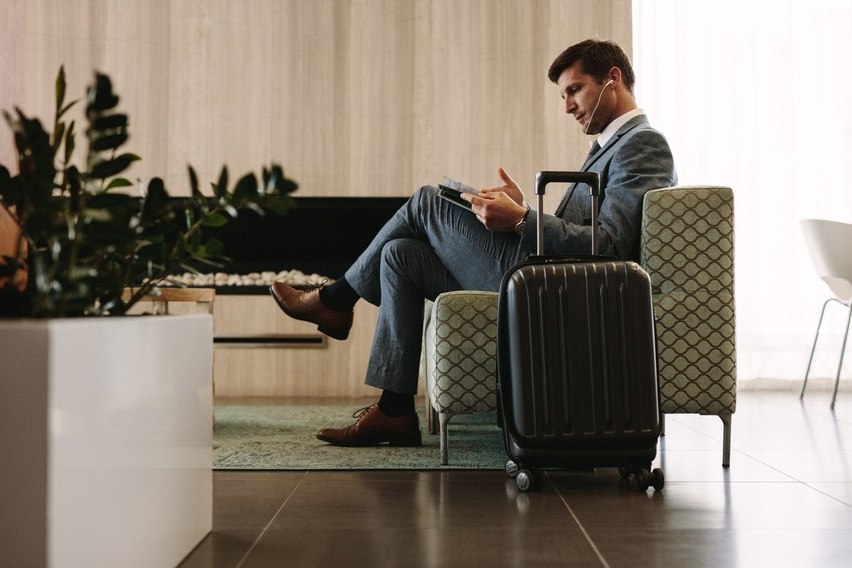 man relaxing in airport lounge
