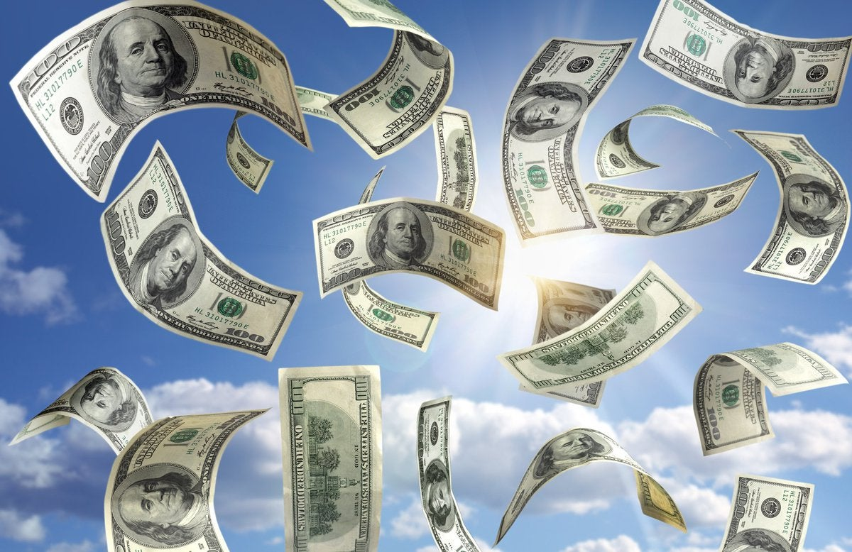 Hundred dollar bills falling from a blue sky.