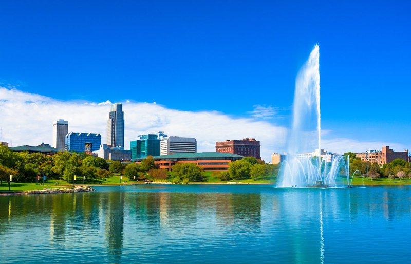 Downtown Omaha, Nebraska, with lake and fountain.