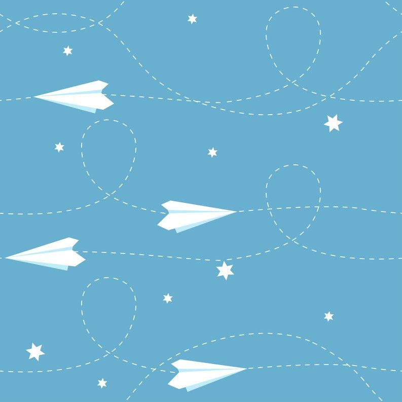 paper airplanes flying among stars