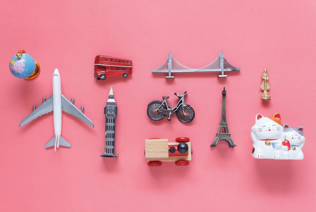 model plane, Big Ben, double-decker bus, and other travel icons