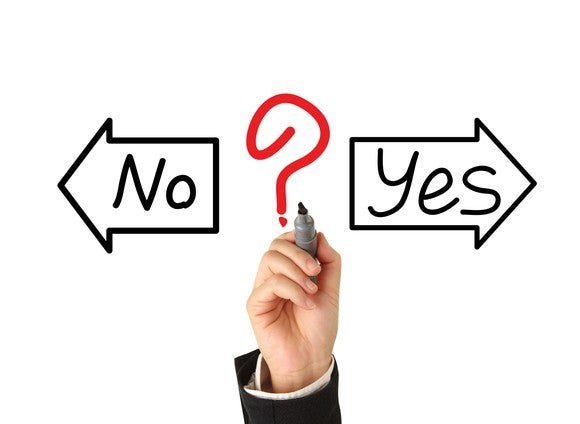 two arrows drawn with the words yes and no in them and a hand drawing a question mark between them
