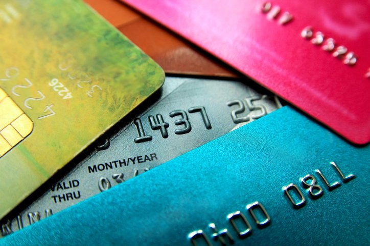 A pile of different colored credit cards.