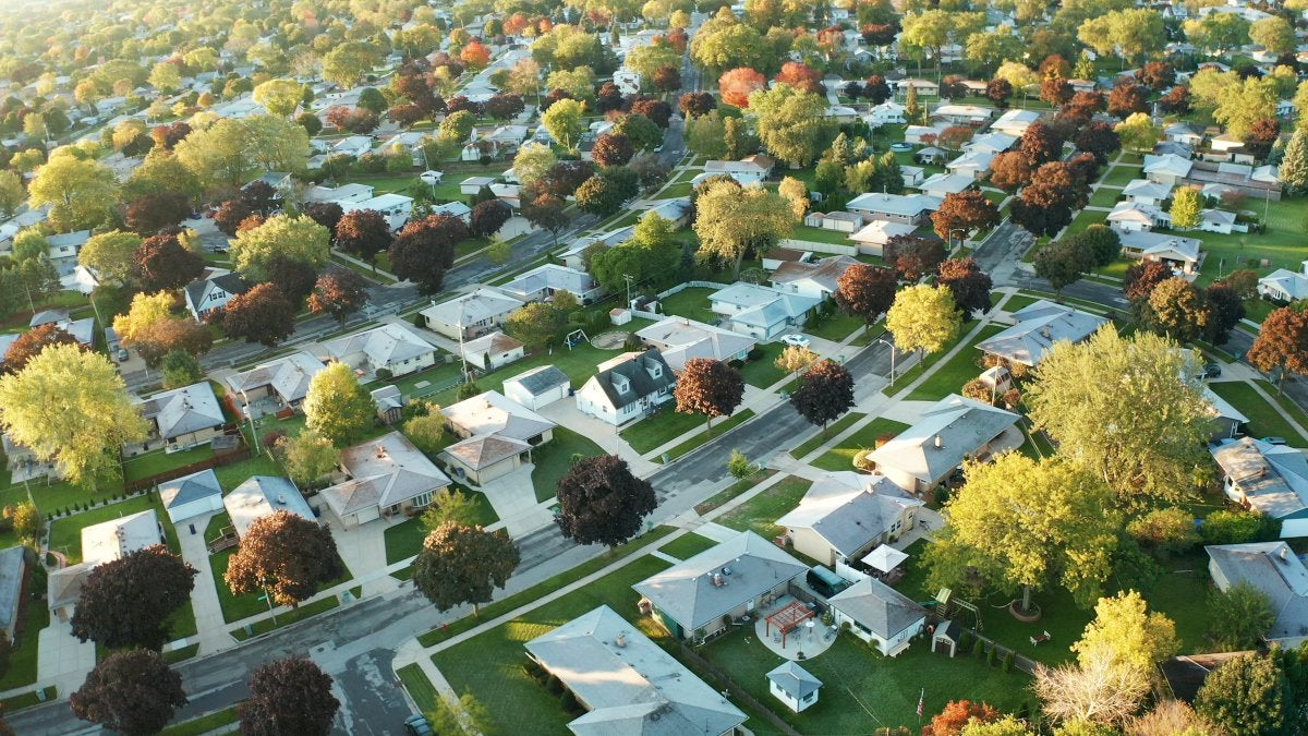 Aerial view of a residential, suburban neighborhood in early autumn.
