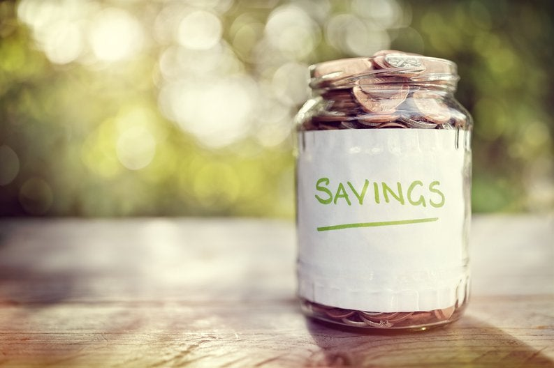 Jar filled to the top with coins labeled SAVINGS