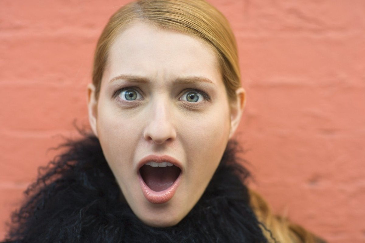 A woman with a shocked expression on her face.