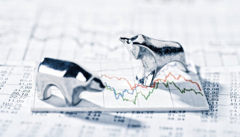 silver animals on top of stock chart