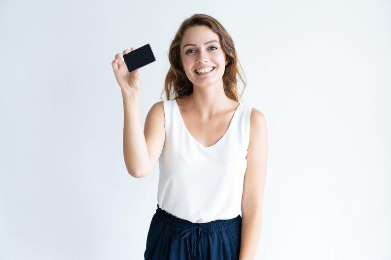 Smiling girl holding black credit card