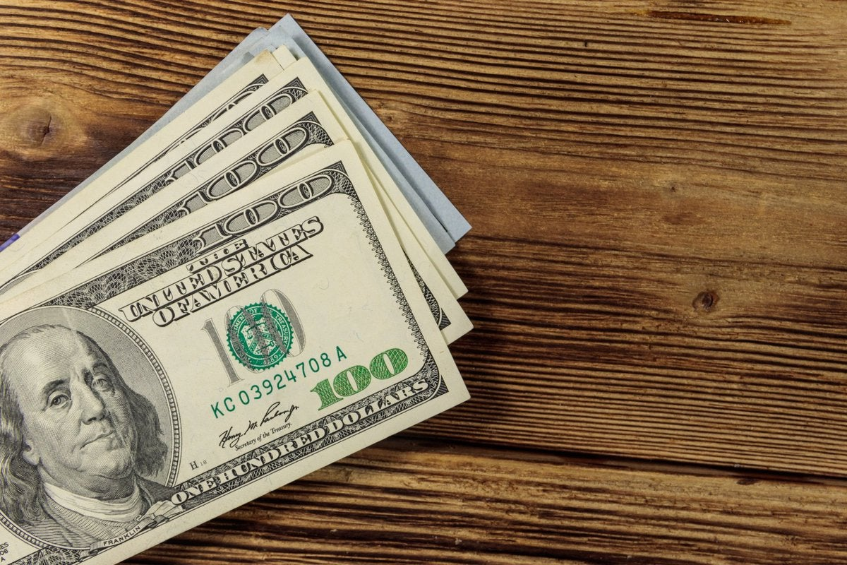 Stack of hundred dollar bills on table