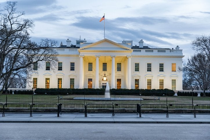 The White House under gray skies.