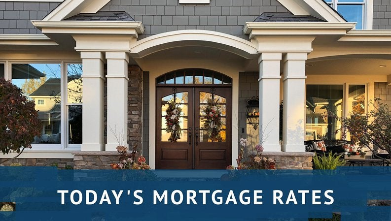 Up-close view of large, fancy home with daily mortgage rates graphics.