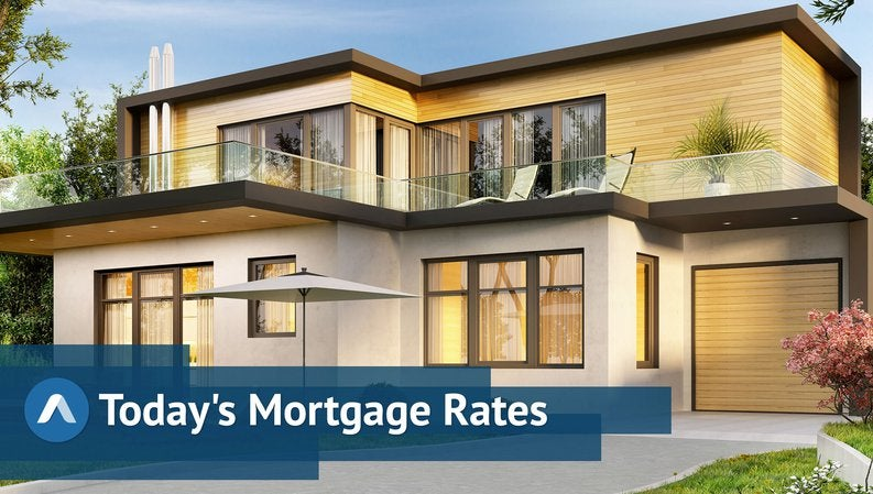 A large, fancy house with daily mortgage rates graphics.