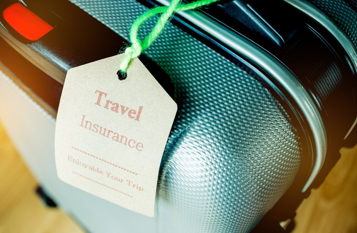 travel insurance tag on suitcase