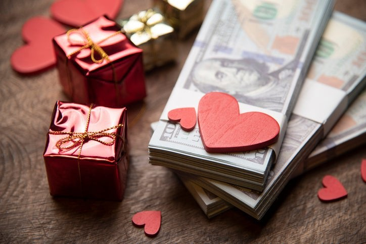 Money, Valentine's gifts, and a red paper heart.