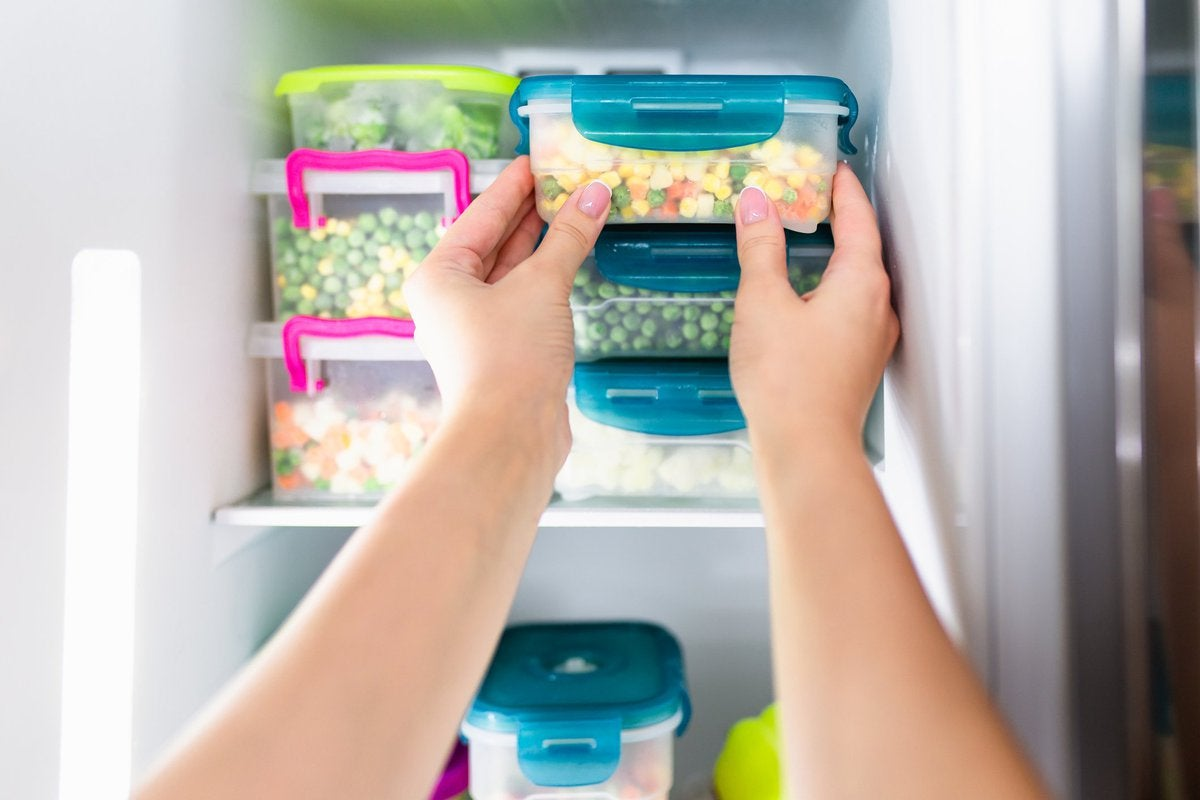 Refrigerator full of vegetables in containers