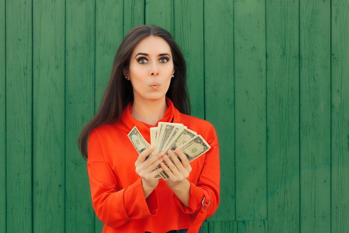 Woman with handfuls of bonus money