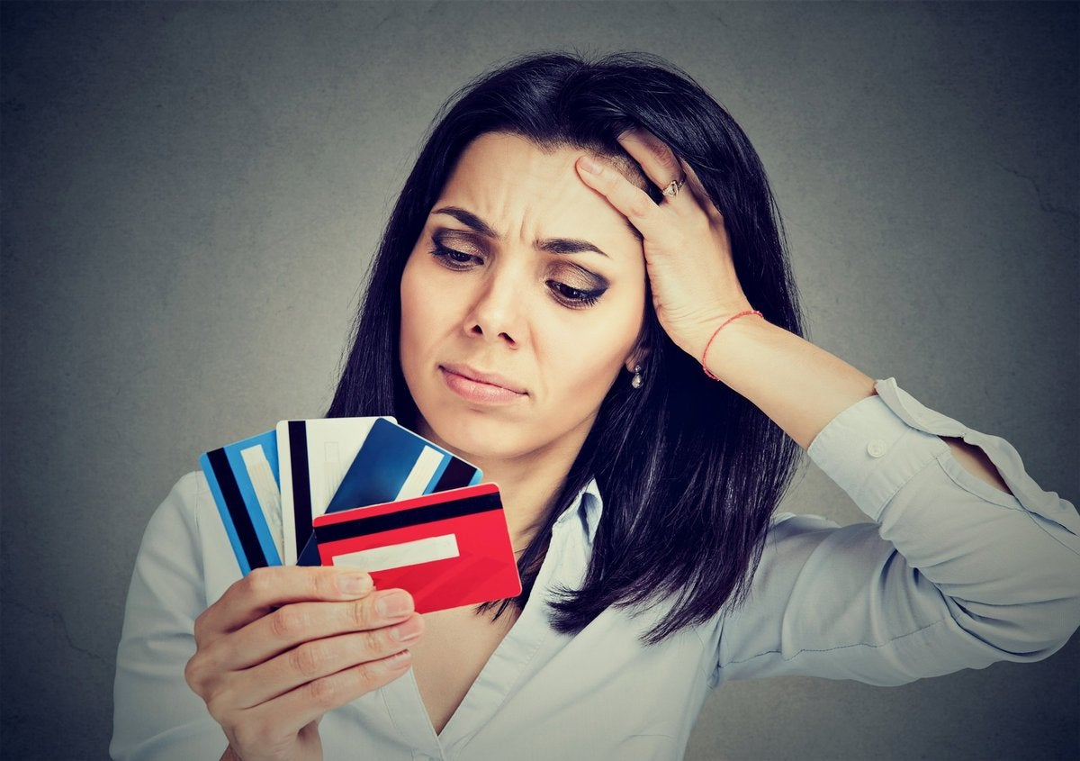 Woman trying to choose best rewards credit card